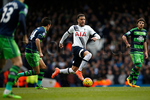 28.02.2016. White Hart Lane, London, England. Barclays Premier League. Kyle Walker of Tottenham Hotspur skips past a challenge from Cork of Swansea during the Barclays Premier League match between Tottenham Hotspur and Swansea City.