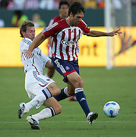 Chivas USA forward Ante Rozov (9) battles for a loose ball against Real Salt Lake midfielder Carey Talley (3). CD Chivas USA beat Real Salt Lake 1-0 in a MLS game at the Home Depot Center in Carson, California, Sunday, August 26, 2007.