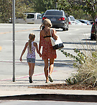 September 4th 2012  <br /> <br /> <br /> Denise Richards shopping at Kitson kids in Malibu California with her daughter. Denise bought some cup cups before leaving malibu at Crumbs shop. Denise was wearing a red yellow flower sun dress carrying a big white handbag purse &amp; 2 big blue bags from Kitson. <br /> <br /> AbilityFilms@yahoo.com<br /> 805 427 3519<br /> www.AbilityFilms.com