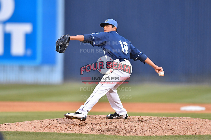 Asheville Tourists pitcher Moises Ceja (17) delivers a pitch during a game against the Columbia Fireflies at McCormick Field on April 14, 2018 in Asheville, North Carolina. The Fireflies defeated the Tourists 7-6. (Tony Farlow/Four Seam Images)