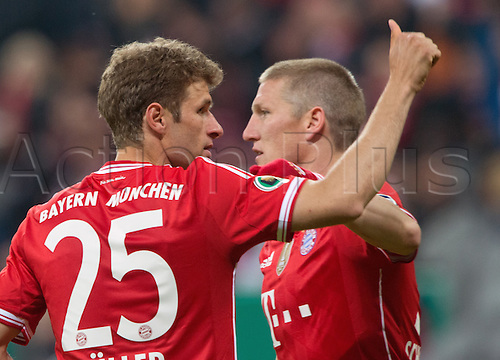 16.04.2014. Munich, Germany. Allianz Arena. Munich's Thomas Mueller (L) celebrates his goal for 3-0 with Bastian Schweinsteiger during the DFB Cup semifinal match between FC Bayern Munich and FC Kaiserslautern at Allianz Arena in Munich, Germany, 16 April 2014.