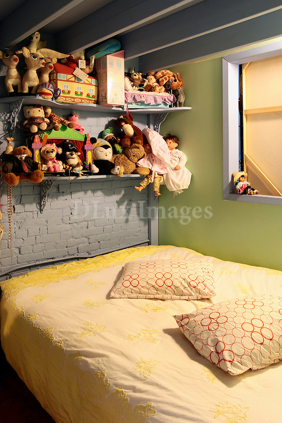 bedroom full of stuffed animals