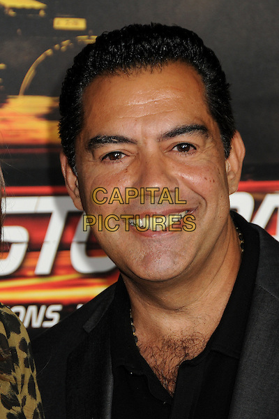 "CARLOS GOMEZ.""Unstoppable"" Los Angeles Premiere held at the Regency Village Theatre, Westwood, California, USA..October 26th, 2010.headshot portrait smiling black hairy chest grey gray.CAP/ADM/BP.©Byron Purvis/AdMedia/Capital Pictures."