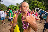 Waimea Bay, North Shore of Oahu, Hawaii.  December 4 2014) Tom Carroll (AUS). - The Opening Ceremony of the 2014 Quiksilver In Memory of Eddie Aikau contest was held this afternoon in the park at Waimea Bay. This winter, the big wave riding event celebrates a special milestone of 30 years. <br /> The Quiksilver In Memory of Eddie Aikau is a one-day big wave riding event that only takes place if and when waves meet a 20-foot minimum height, during the holding period of December 1 through February 28, each Hawaiian winter. The official Opening Ceremony with the Aikau Family will be held on Thursday, December 4th, 3pm, at Waimea Bay.<br />  <br /> &quot;The Eddie&quot; is the original big wave riding event and stands as the measure for every big wave event that exists in the world today. It has become an icon of surfing through its honor, integrity and rarity.<br />  <br /> The event honors Hawaiian hero Eddie Aikau, whose legacy is the respect he held for the ocean; his concern for the safety of all who entered it on his watch; and the way with which he rode Waimea Bay on its most giant and memorable days. <br />  <br /> Adherence to strict wave height standards has ensured its integrity; it is only held on days when waves meet or exceed the Hawaiian 20-foot minimum (wave face heights of approximately 40 feet). This was the threshold at which Eddie enjoyed to ride the Bay. It has been said that what makes The Eddie special is the times it doesn't run, because that is precisely its guarantee of integrity and quality days of giant surf.<br />  <br /> The competition has only been held a total of 8 times: it's inaugural year at Sunset Beach, and then seven more times at its permanent home of Waimea Bay. The Eddie was last held on December 9, 2009, won by California's Greg Long.   Photo: joliphotos.com