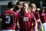 30 August 2013: Elon's Jason Waterman (25) and Nick Butterly (3). The Elon University Phoenix played the Northeastern University Huskies at Koskinen Stadium in Durham, NC in a 2013 NCAA Division I Men's Soccer match. The game ended in a 1-1 tie after two overtimes.