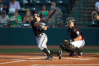 Ian Dawkins (6) of the Kannapolis Intimidators follows through on his swing against the Hickory Crawdads at L.P. Frans Stadium on July 20, 2018 in Hickory, North Carolina. The Crawdads defeated the Intimidators 4-1. (Brian Westerholt/Four Seam Images)