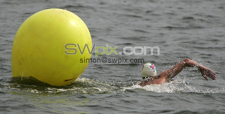 PICTURE BY VAUGHN RIDLEY/SWPIX.COM -  Swimming - Festival of Open Water Swimming - London Regatta Centre, Royal Albert Docks - London, England - 24-25/06/06...? Simon Wilkinson - 07811 267706...Alan Bircher of Great Britain rounds the Start/Finish buoy for the last time in the 10km FINA World Cup.