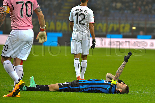 06.03.2016. Milan, Italy.  Mauro Icardi of FC Inter asks for medical assistance during the Italian Serie A League soccer match between Inter Milan and US città Palermo at San Siro Stadium in Milan, Italy.