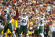 Landover, MD - August 16, 2018: Washington Redskins defensive tackle Tim Settle (97) knocks down New York Jets quarterback Sam Darnold (14) pass during the preseason game between New York Jets and Washington Redskins at FedEx Field in Landover, MD.   (Photo by Elliott Brown/Media Images International)