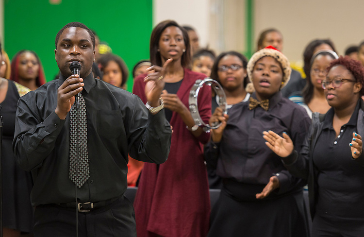 Choir members sing during a beam signing ceremony at Worthing High School, December 11, 2014.