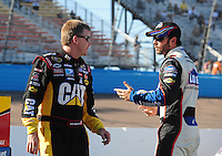 Apr 17, 2009; Avondale, AZ, USA; NASCAR Sprint Cup Series driver Jeff Burton (left) talks with Jimmie Johnson during qualifying for the Subway Fresh Fit 500 at Phoenix International Raceway. Mandatory Credit: Mark J. Rebilas-