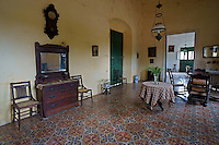 Interior room of main building with colonial antique furniture at Hacienda Yaxcopoil, Yucatan, Mexico.