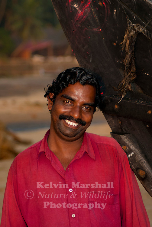 One of the locals waiting by his boat, Alleppey Backwaters, Kerala - Southern India.