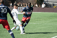 FOXBOROUGH, MA - MARCH 7: Wilfried Zahibo #23 of New England Revolution passes the ball through Alvaro Medran #10 of Chicago Fire's feet during a game between Chicago Fire and New England Revolution at Gillette Stadium on March 7, 2020 in Foxborough, Massachusetts.