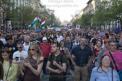 People with EU and Hungarian flags participate in a demonstration against the outcome of the general elections in Budapest, Hungary on April 21, 2018. ATTILA VOLGYI