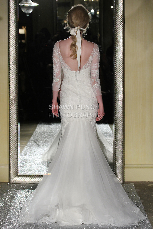 """Model walks runway in a bridal gown from the Oleg Cassini Weddings Autumn Winter 2015 """"Days of Magic"""" collection, at Plaza Athenee, during New York Bridal Fashion Week, April 16, 2015."""