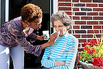 Karen Morris has been caring for her mother Gloria, 80, for the past 10 years. Her mother has Alzheimer's disease and lives with Karen and Karen's husband Richard in their Charlotte, NC home. The pair take in the morning sunshine on the front porch. ..Mrs. Morris was a nurse before she retired and really enjoys taking care of people, she said. Every morning she washes her mother in the bathroom, helps her walk down the stairs, and they share breakfast, as they did Monday, October 18, 2010...Gloria was having an especially bad day and because Karen sees her every day, she knew something was wrong. She later discovered her medication was dehydrating her. That is one of many reasons why having a regular caretaker is so important. ..Kendrick Brinson.LUCEO.Model Released: Yes.AARP Contract #4859.Wichita/Bellovin Bulletin
