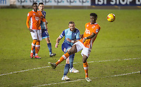 Paul Hayes of Wycombe Wanderers hits a shot at goal past Armand Gnanduillet of Blackpool during the The Checkatrade Trophy match between Blackpool and Wycombe Wanderers at Bloomfield Road, Blackpool, England on 10 January 2017. Photo by Andy Rowland / PRiME Media Images.