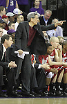 Jeff Hironaka, Washington State assistant coach, directs the Cougars during their 80-69 road victory over arch-rival Washington at the Alaska Airlines Arena in Seattle, Washington, on February 27, 2011.  With the victory, the Cougars swept the regular season series from the Huskies, two games to none.