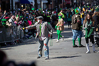 Clowns interact with spectators during the 2013 annual St. Patrick's Day Parade in South Boston, Boston, Massachusetts, USA.