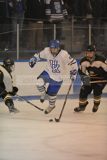 UK player with puck during the University of Kentucky Hockey game against Wright State(OH) at Lexington Ice Center in Lexington, Ky., on 1/22/11. Uk won the game 10-4. Photo by Mike Weaver | Staff