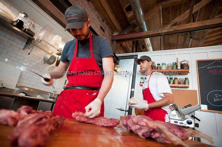 7/31/2010--Seattle, WA, USA...Rain Shadow Meats: One of the best food trends to hit Seattle in recent years: charcuterie. With pork terrine and confit duck gizzards. www.rainshadowmeats.com. Russell Flint, owner of the burgher prepares cuts for customers...The Melrose Market, a new marketplace located in two refurbished historic buildings in Seattle's fashionable Capitol Hill neighborhood. Co-developers Scott Shapiro, of Eagle Rock Ventures, and Liz Dunn, of Dunn & Hobbs, purchased the buildings -- two former automotive shops built in 1919 and 1925  -- in the fall of 2008 with plans to renovate....©2010 Stuart Isett. All rights reserved.