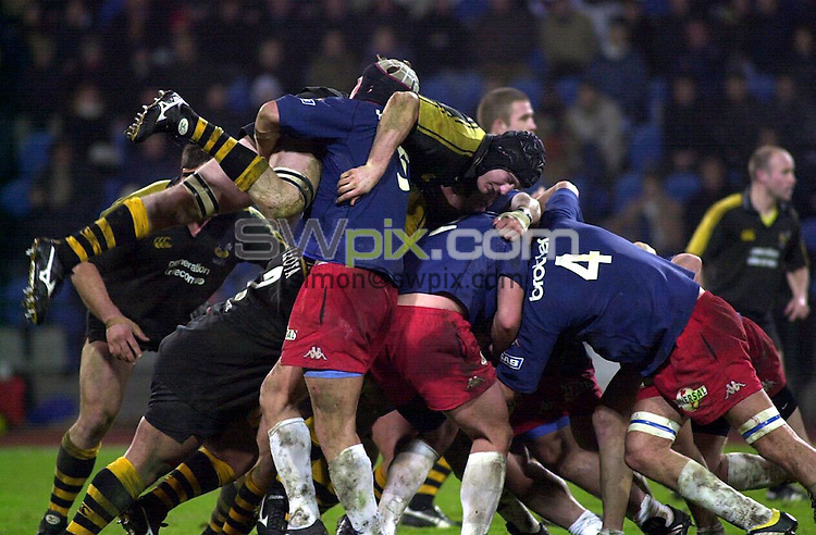 Pix: Dave Winter/SWpix.com. Rugby Union. European Parker Pen Challenge Cup. 2002/2003. Stade Francais v London Wasps...COPYRIGHT PICTURE>>SIMON WILKINSON>>01943 436649>>..Stade Francais Mike James tackles Wasps Richard Birkett in the ruck..