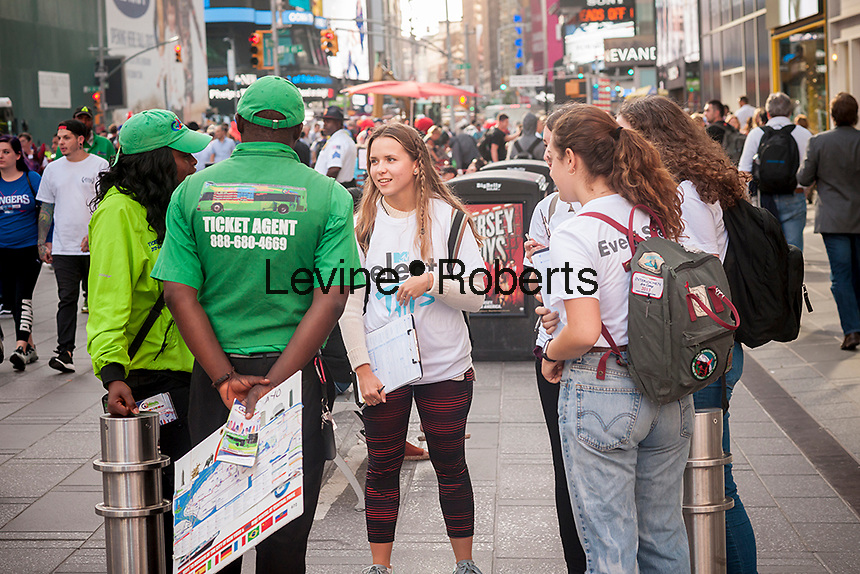 Volunteers from Headcount celebrate National Voter Registration Day in the Times Square in New York on Tuesday, September 27, 2016. The volunteers enticed the non-registered to register to vote. (© Richard B. Levine)
