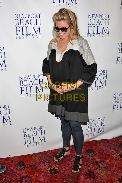 "ADDIE LANE.""Knuckle Draggers"" Premiere at the 2009 Newport Beach Film Festival held at Edwards Cinemas, Newport Beach, CA, USA..April 27th, 2009.full length black dress hands on stomach pregnant grey gray tights sunglasses shades.CAP/ADM/BP.©Byron Purvis/AdMedia/Capital Pictures."