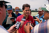 SANTA CLARA, CA:  Coach Steve Mariucci of the San Francisco 49ers talks to the media, including Brian Murphy, Matt Maiocco, and Kevin Lynch, after practice at the Marie P. DeBartolo Sports Centre in Santa Clara, California on May 2, 1997. (Photo by Brad Mangin)