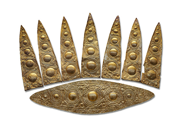 Top leaf shapes of a Mycenaean gold diadem from Grave III, 'Grave of a Women', Grave Circle A, Myenae, Greece. National Archaeological Museum Athens. White Background.<br /> <br /> Cat No 3,5. 16th century BC.<br /> <br /> Shaft Grave III, the so-called 'Grave of the Women,' contained three female and two infant interments. The women were literally covered in gold jewelry and wore massive gold diadems, while the infants were overlaid with gold foil.