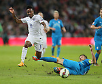England's Raheem Sterling tussles with Slovenia's Bostjan Cesar<br /> <br /> - International European Qualifier - England vs Slovenia- Wembley Stadium - London - England - 15th November 2014  - Picture David Klein/Sportimage