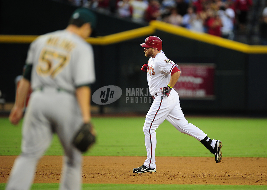 Jun. 8, 2012; Phoenix, AZ, USA; Arizona Diamondbacks outfielder Jason Kubel rounds the bases after hitting a two run home run in the second inning against the Oakland Athletics at Chase Field.  Mandatory Credit: Mark J. Rebilas-