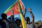 Along with an Eritrean flag, African asylum-seekers protest in front of the Knesset, Israel's parliament in Jerusalem, calling the government to recognize them as refugees and to release those Africans who are held in detention facilities.