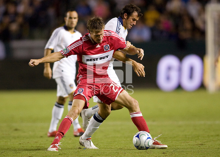 LA Galaxy midfielder Chris Klein and Chicago Fire veteran forward Brian McBride battle. The LA Galaxy defeated the Chicago Fire 1-0 at Home Depot Center stadium in Carson, California on Friday October 2, 2009...