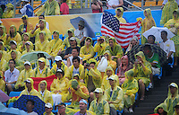 Aug. 10, 2008; Beijing, CHINA; Fans sit in the rain during the match between the United States against Japan during the womens beach volleyball at the Chaoyang Park Beach Volleyball Ground in the 2008 Beijing Olympic Games. The United States won the match. Mandatory Credit: Mark J. Rebilas-