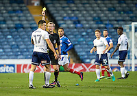 Luke O'Nien of Wycombe Wanderers receives a caution from Referee Gavin Ward during the FA Cup 1st round match between Portsmouth and Wycombe Wanderers at Fratton Park, Portsmouth, England on the 5th November 2016. Photo by Liam McAvoy.