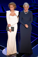 Jane Fonda, left, and Helen Mirren present the award for best performance by an actor in a leading role at the Oscars on Sunday, March 4, 2018, at the Dolby Theatre in Los Angeles. (Photo by Chris Pizzello/Invision/AP)