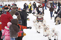 Saturday March 6 , 2010   Jim Lanier and team make their way through the specators along the trail near Tudor Road during the ceremonial start of the 2010 Iditarod in Anchorage , Alaska
