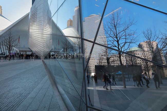 Reflections on the wall of the National September 11 Memorial & Museum, designed by Davis Brody Bond, Michael Arad and Peter Walker, on the site of the original Twin Towers World Trade Center buildings which were destroyed in the terrorist attack of 11th September 2001, Manhattan, New York, New York, USA. The memorial and museum commemorate the 9/11 attacks, which killed 2,977, and the World Trade Center bombing of 1993, which killed 6. The memorial forms part of the new World Trade Center complex, which includes 5 skyscrapers and the museum. The memorial consists of 2 enormous reflecting pools and waterfalls within the footprint of the Twin Towers, surrounded by trees. Picture by Manuel Cohen