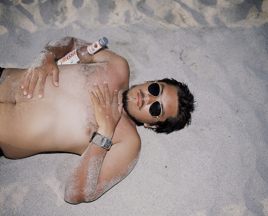 "A man passed out on the beach of Zicatela, Puerto Escondido during the easter week holidays 2006. Exhibited in the Salon Malafama as part of the ""Vacaciones"" series, Mexico City July, 2006"