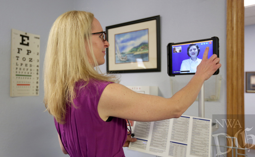 NWA Democrat-Gazette/DAVID GOTTSCHALK  Taylor Kelamis, nurse practitioner, interacts with an interpreter through an iPad Wednesday, July 3, 2019, at the Mercy Clinic in Springdale. The program, that offers 200 different languages, is helping to serve non English speaking patients.