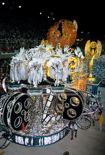 Rio de Janeiro, Brazil. Carnival; procession float in silver gold and black with Hollywood film theme.