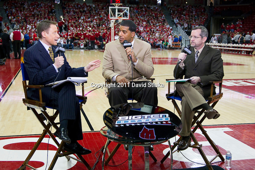 Dave Revsine (from left to right), Jim Jackson, and Mike DeCoursey of the Big Ten Network  talk during a pre-game show prior to the Wisconsin Badgers Big Ten Conference NCAA men's college basketball game against #1 ranked Ohio State Buckeyes at the Kohl Center on February 12, 2011 in Madison, Wisconsin. Wisconsin won 71-67. (Photo by David Stluka)
