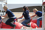 From left, Rebecca Kitchen, Van Tieu and Wendy Damonte compete in a media exhibition race at the 56th annual International Camel &amp; Ostrich Races in Virginia City, Nev. on Friday, Sept. 11, 2015. <br /> Photo by Cathleen Allison