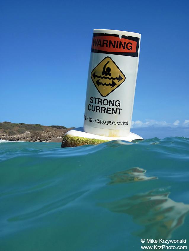 Warning, Strong Current buoy floating in water in Hanauma Bay, Honolulu, Oahu, Hawaii