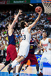 Real Madrid's player Sergio Llull and Barcelona's player Tomic during Liga Endesa 2015/2016 Finals 4th leg match at Barclaycard Center in Madrid. June 20, 2016. (ALTERPHOTOS/BorjaB.Hojas)