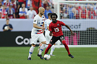 CLEVELAND, OHIO - JUNE 22: Michael Bradley #4, Nathan Lewis #13 during a 2019 CONCACAF Gold Cup group D match between the United States and Trinidad & Tobago at FirstEnergy Stadium on June 22, 2019 in Cleveland, Ohio.