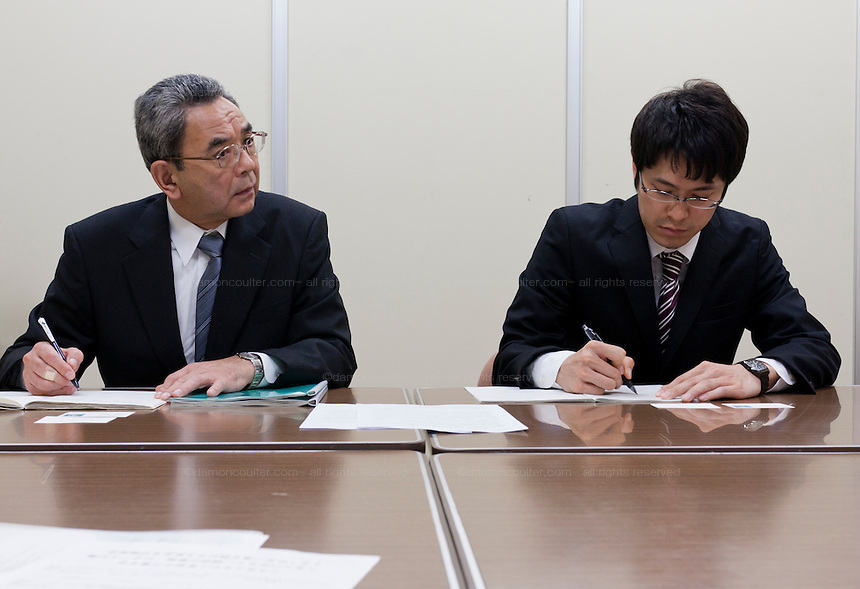 Officials from the Cabinet Office listen and make notes as as organizers of the Anti nuclear protest by women outside the Ministry of Economy, Trade and Industry (METI) visit to present their demands. Tokyo Japan. Friday November 4th 2011. The protest ran from October 27th to Noverber 5th. Originally started my mothers from Fukushima protesting about nuclear contamination from October 30th to November 5th the protest welcomed women and people from all over Japan.