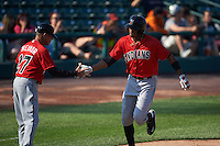 Indianapolis Indians outfielder Keon Broxton (24) is congratulated by manager Dean Treanor (27) after hitting a two run home run during a game against the Rochester Red Wings on June 10, 2015 at Frontier Field in Rochester, New York.  Indianapolis defeated Rochester 5-3.  (Mike Janes/Four Seam Images)